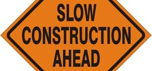 Slow! Construction Ahead. Sign
